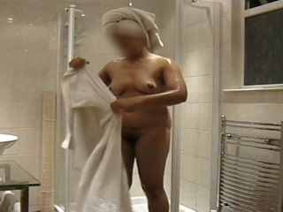 Indian girlfriend showering, watch her soap up her tits and trimmed pussy