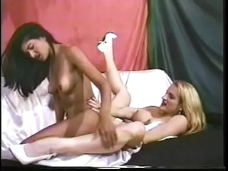 Indian cutie pie Nadia Nyce and busty fairhaired hottie Kimberly Kyle are fond of playing with big double-sided dildo during nasty interracial Sapphic game